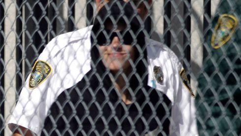 Teen pop star Justin Bieber, in a black hooded sweatshirt, departs a Miami-Dade County jail. Photograph: Andrew Innerarity/Reuters
