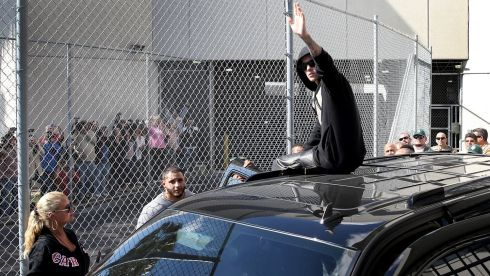 Bieber waves after exiting from the Turner Guilford Knight Correctional Center. Photograph: Joe Raedle/Getty Images