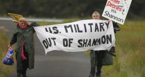 Struggle for peaceful means: Niall Farrell and Margaretta D'Arcy attempting to block the runway at Shannon in protest at the use of the airport by the US military. Photograph: Niall Carson/PA Wire