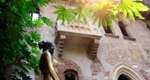 Juliet's balcony and statue in Verona: touching her right breast is said to bring luck in love. Photograph: Getty Images