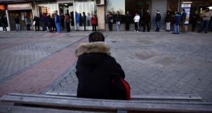 People wait in line in front of a government-run employment office in Madrid. Photograph: Andrea Comas/Reuters