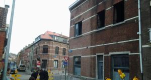 The women's remains were found in a red brick building which was serving as a student residence on Bank Straat in Leuven shortly after 9am. Eight other students, including six Irish nationals, were rescued from the fire in the university city. Photograph: Suzanne Lynch/The Irish Times
