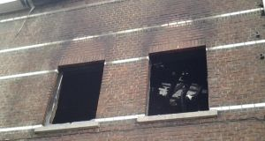 Heavy fire damage visible through smoke-blackened window openings. Photograph: Suzanne Lynch/The Irish Times