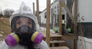 Shake and bake: Jennifer Rhyne of Affordable Cleanup outside a meth lab in Scott Depot. Photograph: Simon Carswell
