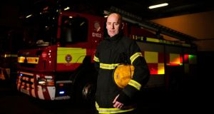 Glad to be home: firefighter Vincent Donegan. Photograph: Aidan Crawley