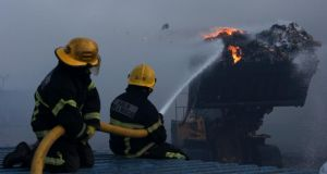 Up in smoke: fighting the blaze. Photograph: Brian Lawless/PA Wire