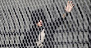 On bail: Justin Bieber waves to fans as he leaves jail in Miami after being released on bail. Photograph: Andrew Innerarity/Reuters