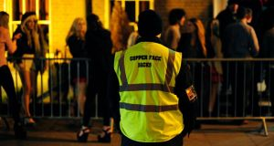 On the floor: dancing and queuing at Copper Face Jacks night club on Harcourt Street, in Dublin, this week. Photograph: Aidan Crawley 31/01/2014....FeaturesA member of Copper Face Jacks security staff picutred the night club in Harcourt Street, Dublin.Photograph: Aidan Crawley
