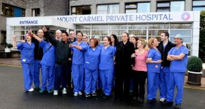"Some of Mount Carmel's 300 employees outside the hospital yesterday. Staff described the closure of the private hospital after 65 years as ""like a bereavement"" and ""extremely sad"". Most staff members completed their last shift yesterday afternoon. photograph: david sleator"
