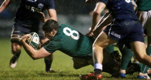 Ireland's Jack O'Donoghue scores the opening try in last night's Under-20 Six Nations match against Scotland in Dubarry Park, Athlone. Photograph: James Crombie/Inpho