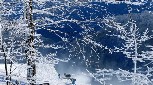Work continues on the snowboarding course in Rosa Khutor. Photograph: Mike Blake/Reuters