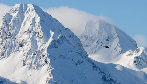 A military helicopter patrols in the mountains of Krasnaya Polyana ahead of the Sochi games. Photograph: Filip Singer/EPA