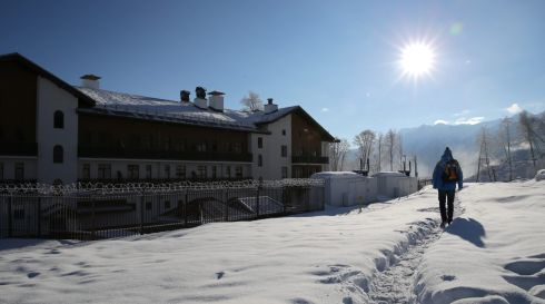 An Olympic Games volunteer walks past the Mountain Olympic Village Derevnya at the Rosa Khutor Alpine Resort. Photograph: Michael Kappeler/EPA