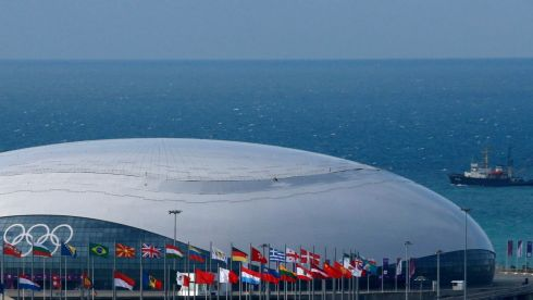A ship sails past the Bolshoy Ice Dome at the Adler district of Sochi. Photograph: Alexander Demianchuk/Reuters