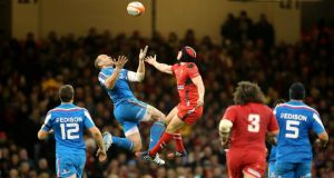 Wales' Leigh Halfpenny and Sergio Parisse of Italy challenge for the high ball at the Millennium Stadium. Photograph: Cathal Noonan/Inpho