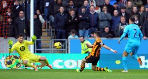 Shane Long scores his first goal for Hull City during today's 1-1 draw with Tottenham at the KC Stadium. Photograph: Tim Keeton/Getty Images