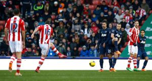Stoke City's Charlie Adam  scores his first goal against Manchester United. Photograph: Darren Staples/Reuters
