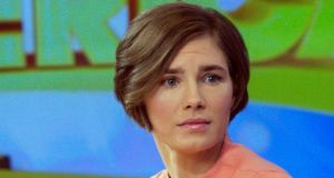 Amanda Knox reacts while being interviewed on the set of ABC's Good Morning America in New York yesterday. Photograph: Reuters