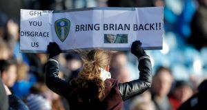 A Leeds United's supporter shows her support for Brian McDermott during today's 5-1 win over Huddersfield. Photograph: Richard Sellers/PA Wire.
