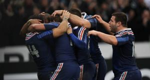 Gael Fickou celebrates his try with his teammates. Photograph: Billy Stickland/Inpho