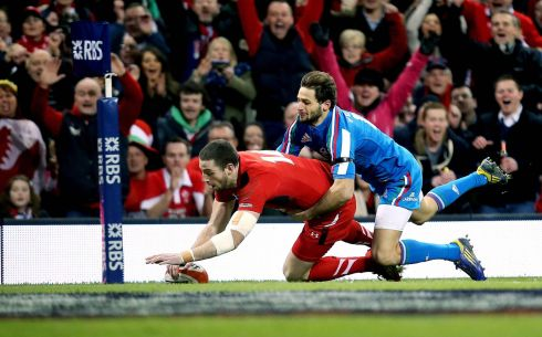 Wales' Alex Cuthbert scores the opening try despite the attentions of Angelo Esposito. Photograph: James Crombie/Inpho