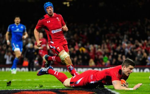 Wales player  Scott Williams crosses for the second Wales try.  Photograph: Stu Forster/Getty Images