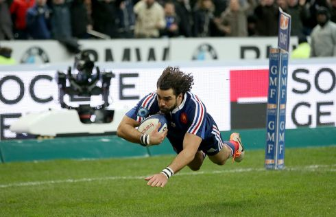 France's Yoann Huget scores the opening try of the game against England. Photograph: Billy Stickland/Inpho