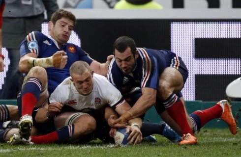 Mike Brown scrambles over for England's first try: Photograph: Christophe Karaba/EPA