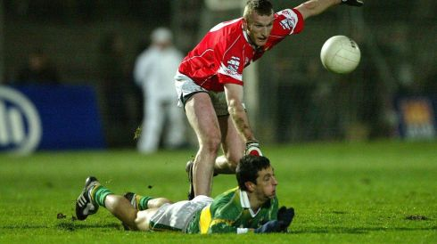Galvin is tackled by Nicholas Murphy of Cork in the 2004 season. Photograph: Lorraine O'Sullivan/Inpho