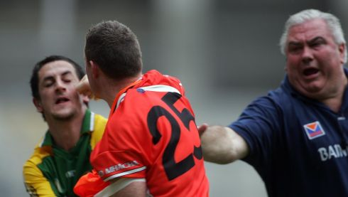 Galvin and John Toal of Armagh have a punch up during the 2006 quarter-final as Armagh manager Joe Kernan tries to intervene. Photograph: Lorraine O'Sullivan/Inpho