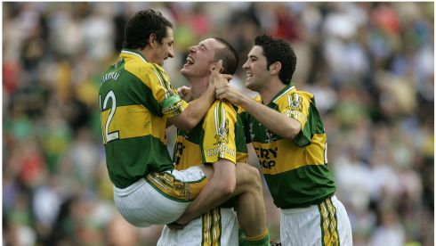Paul Galvin, jumps into the arms of Kieran Donaghy, with Bryan Sheehan, (right) as Kerry  celebrate beating Mayo in the All-Ireland final in 2006. Photographer: Dara Mac Donaill/The Irish Times