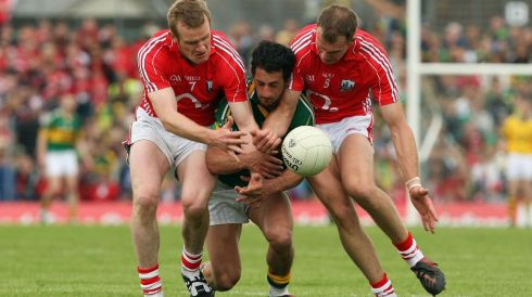 Cork's Ger Spillane and Alan O'Connor tackle  Galvin in the 2009 Munster semi-final. Photograph: Cathal Noonan/Inpho
