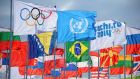 The IOC, United Nations and Sochi 2014 flags fly in front of national flags in the Coastal Athlete's Village at the Sochi Winter Olympics. Photograph: Reuters