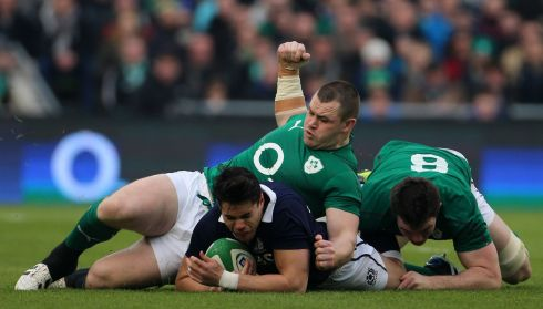 Ireland's Cian Healy and Peter O'Mahony tackle Scotland's Sean Maitland during the opening exchanges at the Aviva Stadium. Photo: Niall Carson/PA Wire.