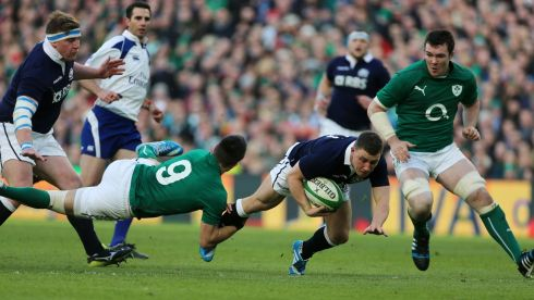 Ireland's Conor Murray hauls down Duncan Weir. Photo: Niall Carson/PA Wire.