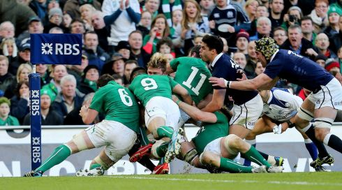 Scotland's Dave Denton is tackled into touch just short of the try line. Photograph: James Crombie/Inpho