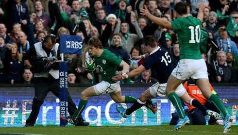 Ireland's Andrew Trimble goes past the tackle of Scotland's Stuart Hogg to score the  first try. Photograph: Brian Lawless/PA Wire.