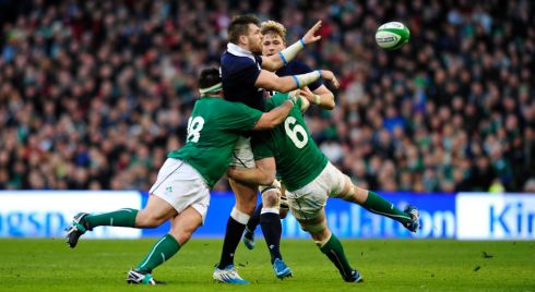 Scotland's Johnnie Beattie is tacked by Peter O'Mahony and Martin Moore.  Photograph: Aidan Crawley/EPA