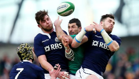 Rob Kearney with Ryan Wilson and Sean Lamont  of Scotland. Photograph: Dan Sheridan/Inpho