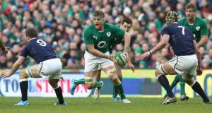 Jamie Heaslip of Ireland charges upfield against Scotland at the Aviva Stadium. Photograph:  David Rogers/Getty Images