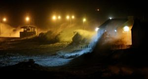 Large waves caused by high winds and spring tides batter the coastal town of Lahinch, Co Clare, on Saturday. Photograph: Niall Carson/PA