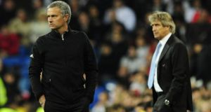 Jose Mourinho and  Manuel Pellegrini: The two managers have very different personalties. Photograph:  Javier Soriano/AFP/Getty Images