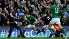 Andrew Trimble goes past the tackle of Scotland's Stuart Hogg to score Ireland's  first try at the Aviva. Photograph: PA