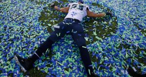 Seattle Seahawks' Malcom Smith makes an angel in the confetti after his team defeated the Denver Broncos in the NFL Super Bowl XLVIII football game in East Rutherford, New Jersey. Photograph: Shannon Stapleton/Reuters