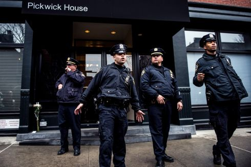 Police stand outside the apartment building where the actor was found dead. Photograph: Robert Stolarik/The New York Times