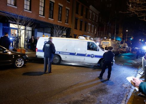 The New York City Medical Examiner's van leaves Pickwick House with the body of the actor. Photograph: Jemal Countess/Getty Images