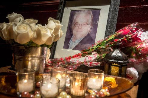 A makeshift memorial sits outside the apartment building where the body of actor Philip Seymour Hoffman was found.  Photograph: Gary He/EPA