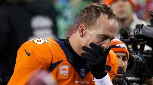 It is not a good day for the Denver Broncos as they lose the game.  Quarterback Peyton Manning leaves the field. Photograph: Brendan McDermid/Reuters