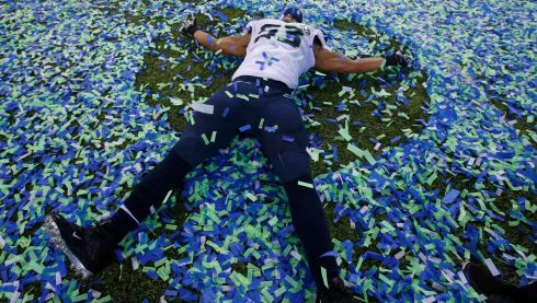 But it is a good day for the Seattle Seahawks as player Malcom Smith makes an angel in the confetti after his teams' victory. Photograph: Shannon Stapleton/Reuters