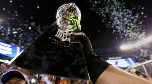 Seattle Seahawk players celebrate with the Vince Lombardi trophy. Photograph: Carlo Allegri/Reuters